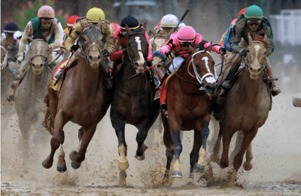 Jockeys fight for position during the 145th running of the Kentucky Derby at Churchill Downs. (Andy Lyons/Getty Images)